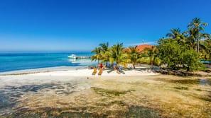 Private beach, white sand, free beach cabanas, beach towels