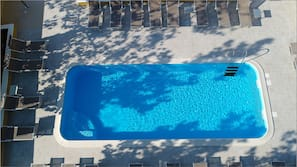 Seasonal outdoor pool, pool loungers