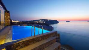 Outdoor pool, an infinity pool, pool loungers
