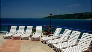 Outdoor pool, a waterfall pool, free cabanas, pool umbrellas