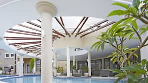 Outdoor pool, open 8:00 AM to 7:00 PM, pool loungers