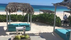 Beach nearby, white sand, free beach cabanas, beach towels