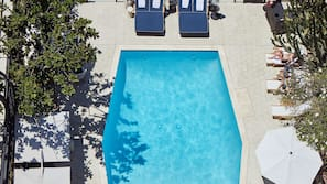 Outdoor pool, open 8:00 AM to 8:00 PM, pool umbrellas