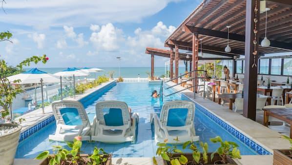 2 outdoor pools, pool umbrellas, sun loungers
