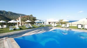 Seasonal outdoor pool, open 9:00 AM to 8:00 PM, free cabanas
