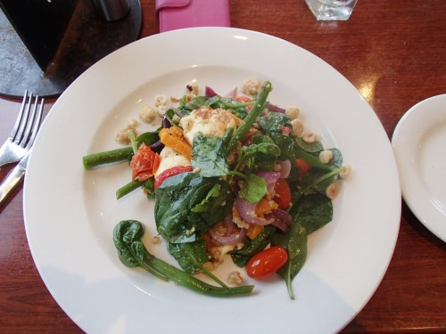 Haloumi Salad-- grilled haloumi, roast pumpkin, red peppers, green beans, baby spinach, burghul and hazelnut vinaigrette .