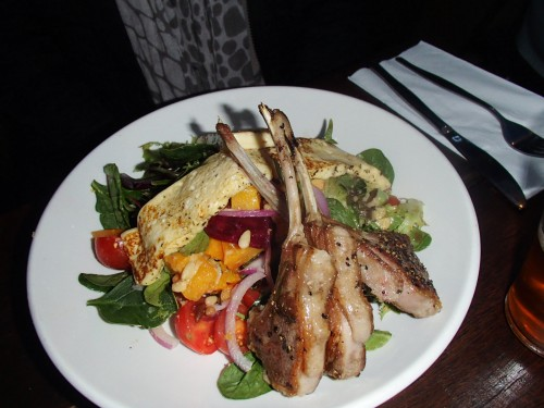 Lamb cutlets with a rainbow veggie and haloumi salad.