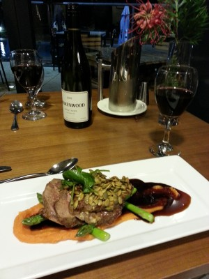 Roasted lamb rump with a mustard and pepita crust, sweet potato, and asparagus
