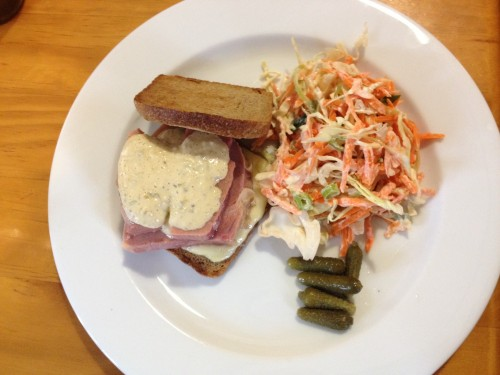 The Reuben: corned beef and melted cheese on sourdough with sauce, pickles and coleslaw