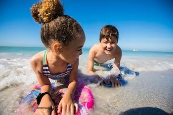 On the beach, white sand, free beach cabanas, beach towels