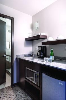 Mini-fridge, microwave, coffee/tea maker, cookware/dishes/utensils