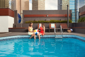 Outdoor pool, open 6 AM to 10:30 PM, pool loungers