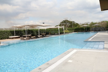 Outdoor pool, open 7:00 AM to 9:00 PM, sun loungers