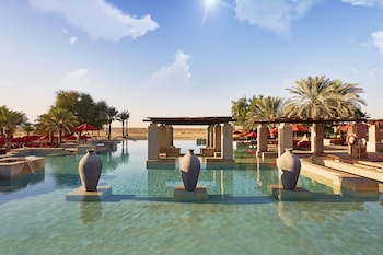 2 outdoor pools, open 8:00 AM to 7:00 PM, pool umbrellas, pool loungers