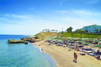 Private beach, beach cabanas, beach towels, beach massages