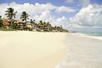 Private beach, white sand, free beach cabanas, beach umbrellas