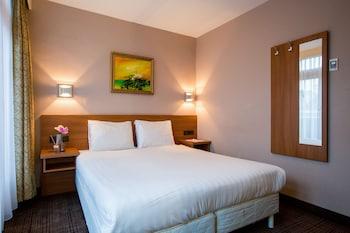 Select Comfort-bedden, een kluis op de kamer, een bureau