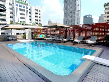 Outdoor pool, open 6 AM to 10 PM, pool umbrellas, sun loungers