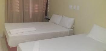 Frigobar, cortinas blackout, Wi-Fi de cortesia, roupa de cama