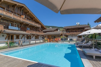 Outdoor pool, open 10:00 AM to 9:00 PM, pool umbrellas, pool loungers