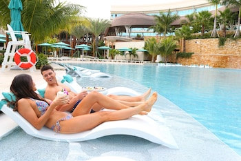 3 outdoor pools, open 8:00 AM to 8:00 PM, cabanas (surcharge)