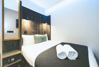 Een kluis op de kamer, verduisterende gordijnen, gratis wifi, beddengoed