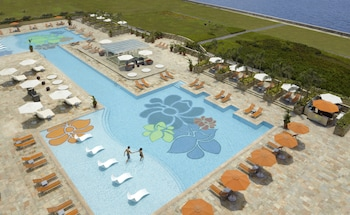 Outdoor pool, open 6:00 AM to 9:00 PM, pool cabanas (surcharge)