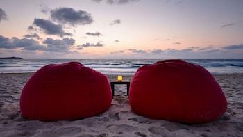 On the beach, sun-loungers, beach towels, beach bar